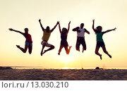 Купить «smiling friends dancing and jumping on beach», фото № 13030210, снято 3 августа 2014 г. (c) Syda Productions / Фотобанк Лори