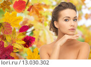 Купить «beautiful woman touching her face over autumn», фото № 13030302, снято 17 марта 2013 г. (c) Syda Productions / Фотобанк Лори