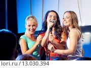 Купить «three happy women singing on night club stage», фото № 13030394, снято 20 октября 2014 г. (c) Syda Productions / Фотобанк Лори