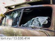 Купить «war truck with broken windshield glass outdoors», фото № 13030414, снято 30 сентября 2015 г. (c) Syda Productions / Фотобанк Лори