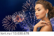 Купить «beautiful woman with diamond earring over firework», фото № 13030678, снято 17 марта 2013 г. (c) Syda Productions / Фотобанк Лори