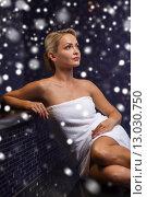 Купить «beautiful woman sitting in bath towel at sauna», фото № 13030750, снято 15 декабря 2014 г. (c) Syda Productions / Фотобанк Лори