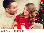 Купить «smiling father and daughter looking at each other», фото № 13030990, снято 26 октября 2013 г. (c) Syda Productions / Фотобанк Лори