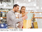 Купить «happy young couple with shopping bags in mall», фото № 13031130, снято 10 ноября 2014 г. (c) Syda Productions / Фотобанк Лори