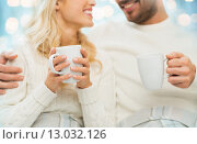 Купить «close up of happy couple with tea cups at home», фото № 13032126, снято 8 октября 2015 г. (c) Syda Productions / Фотобанк Лори