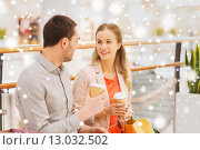 Купить «happy couple with shopping bags drinking coffee», фото № 13032502, снято 10 ноября 2014 г. (c) Syda Productions / Фотобанк Лори