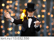 Купить «magician in top hat showing trick», фото № 13032550, снято 12 сентября 2013 г. (c) Syda Productions / Фотобанк Лори