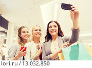 Купить «women with smartphones shopping and taking selfie», фото № 13032850, снято 3 ноября 2014 г. (c) Syda Productions / Фотобанк Лори