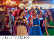 Купить «happy friends with champagne dancing at nightclub», фото № 13032906, снято 20 октября 2014 г. (c) Syda Productions / Фотобанк Лори