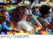 Купить «happy friends dancing at night club», фото № 13032910, снято 20 октября 2014 г. (c) Syda Productions / Фотобанк Лори