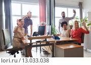 Купить «happy creative team waving hands in office», фото № 13033038, снято 29 марта 2015 г. (c) Syda Productions / Фотобанк Лори