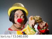 Купить «Funny clown against dark background», фото № 13040690, снято 16 сентября 2015 г. (c) Elnur / Фотобанк Лори