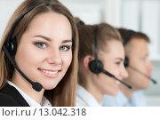 Купить «Портрет работника call центра с коллегами», фото № 13042318, снято 2 июля 2015 г. (c) Людмила Дутко / Фотобанк Лори
