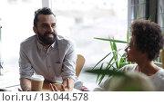 Купить «happy creative team with coffee talking in office», видеоролик № 13044578, снято 2 апреля 2015 г. (c) Syda Productions / Фотобанк Лори