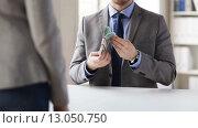 Купить «close up of businessman taking money bribe», видеоролик № 13050750, снято 12 апреля 2015 г. (c) Syda Productions / Фотобанк Лори