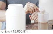 Купить «close up of man with protein shake bottle and jar», видеоролик № 13050814, снято 16 мая 2015 г. (c) Syda Productions / Фотобанк Лори