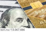 Купить «Кредитная карта на фоне американских долларов», фото № 13067886, снято 15 ноября 2015 г. (c) FotograFF / Фотобанк Лори