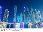 Купить «Dubai - JANUARY 10, 2015: Marina district on January 10 in UAE, Dubai. Marina district is popular residential area in Dubai», фото № 13069878, снято 10 января 2015 г. (c) Elnur / Фотобанк Лори
