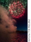Купить «Fireworks display at night on Canada Day, Kenora, Lake Of The Woods, Ontario, Canada», фото № 13102262, снято 1 июля 2014 г. (c) Ingram Publishing / Фотобанк Лори