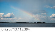 Купить «Rainbow over a lake, Lake of the Woods, Ontario, Canada», фото № 13115394, снято 1 сентября 2014 г. (c) Ingram Publishing / Фотобанк Лори