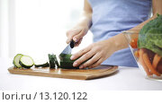 smiling young woman chopping squash at home. Стоковое видео, видеограф Syda Productions / Фотобанк Лори
