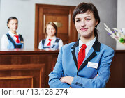 Купить «Hotel reception worker», фото № 13128274, снято 27 октября 2015 г. (c) Дмитрий Калиновский / Фотобанк Лори