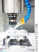 Купить «drilling hole or boring detail with lubricant liquid coolant», фото № 13131158, снято 9 апреля 2015 г. (c) Дмитрий Калиновский / Фотобанк Лори