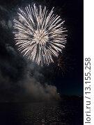 Купить «Fireworks display at night on Canada Day, Kenora, Lake Of The Woods, Ontario, Canada», фото № 13155258, снято 1 июля 2014 г. (c) Ingram Publishing / Фотобанк Лори