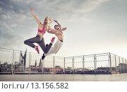 Купить «Athletic couple during the jump training», фото № 13156582, снято 6 сентября 2014 г. (c) Ingram Publishing / Фотобанк Лори