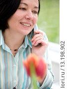 Купить «Woman talking on a cordless telephone», фото № 13198902, снято 28 февраля 2009 г. (c) age Fotostock / Фотобанк Лори