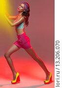 Купить «Attractive young woman pushing shining wall», фото № 13206070, снято 21 декабря 2013 г. (c) Ingram Publishing / Фотобанк Лори