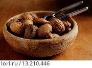 Купить «Mixed nuts in bowl», фото № 13210446, снято 8 июля 2020 г. (c) age Fotostock / Фотобанк Лори