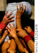Купить «Detail of Xiquets de Reus ´Castellers´ building human tower, a Catalan tradition  Plaça Nova Alcover Tarragona province,Catalonia, Spain», фото № 13212618, снято 25 февраля 2020 г. (c) age Fotostock / Фотобанк Лори