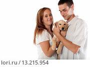 Купить «Young couple with labrador retriever puppy», фото № 13215954, снято 18 августа 2019 г. (c) age Fotostock / Фотобанк Лори
