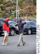 Купить «A teenage drum major practices marching with his baton while a friends makes a video in a San Clemente, CA, high school parking lot  The drum major is...», фото № 13257270, снято 10 июля 2020 г. (c) age Fotostock / Фотобанк Лори