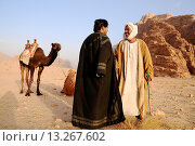 Купить «Beduin men with their camels, Wadi Rum desert, Jordan, Middle East.», фото № 13267602, снято 17 декабря 2009 г. (c) age Fotostock / Фотобанк Лори