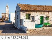 Купить «A vacation beach house and the Las Salinas Church in the town of Cabo de Gata, Almeria, Spain», фото № 13274022, снято 17 мая 2010 г. (c) age Fotostock / Фотобанк Лори