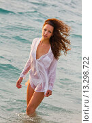 Sexy young woman on the beach in a White shirt. Стоковое фото, фотограф Emil Pozar / age Fotostock / Фотобанк Лори