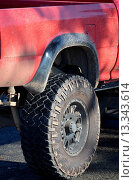Купить «Off_road endurance tyre and hub on a red 4x4 truck showing specialised tread and strengthening of the side wall», фото № 13343614, снято 16 февраля 2019 г. (c) age Fotostock / Фотобанк Лори
