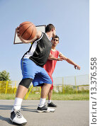 Купить «streetball basketball game with two young player at early morning on city court», фото № 13376558, снято 19 января 2020 г. (c) age Fotostock / Фотобанк Лори