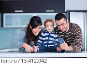 Купить «happy young family have fun and relaxing at new home with bright furniture», фото № 13412042, снято 21 ноября 2017 г. (c) age Fotostock / Фотобанк Лори