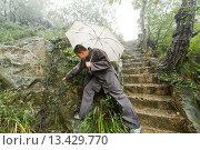 Купить «Shaolin Monk Shi De Jian examining vegetation at the San Huang Zhai Monastery on the Song Mountain, China», фото № 13429770, снято 28 сентября 2008 г. (c) age Fotostock / Фотобанк Лори
