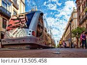 Купить «Low angle view of a streetcar, Constitution Avenue, Seville, Spain», фото № 13505458, снято 27 марта 2009 г. (c) age Fotostock / Фотобанк Лори