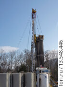 Купить «Williamsport, Pennsylvania - A natural gas well being drilled in rural Lycoming County in preparation for hydraulic fracturing fracking  In the background is Rose Valley Lake», фото № 13548446, снято 5 июля 2020 г. (c) age Fotostock / Фотобанк Лори