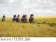Купить «Группа велосипедистов едет по грунтовой дороге вдоль морского побережья западного Крыма», фото № 13551266, снято 26 июня 2009 г. (c) Николай Голицынский / Фотобанк Лори