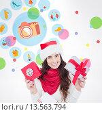 Купить «Composite image of happy brunette holding christmas gifts», фото № 13563794, снято 19 февраля 2019 г. (c) Wavebreak Media / Фотобанк Лори