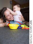 Купить «Mommy and baby playing in the floor», фото № 13597206, снято 10 сентября 2010 г. (c) age Fotostock / Фотобанк Лори