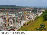 Купить «building site of a new flight of locks at Gatun that will allow the transit of Post-Panamax vessels, Republic of Panama, Central America», фото № 13636890, снято 25 марта 2019 г. (c) age Fotostock / Фотобанк Лори