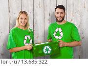 Купить «Composite image of portrait of smiling volunteers carrying recycling container», фото № 13685322, снято 20 марта 2019 г. (c) Wavebreak Media / Фотобанк Лори