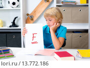 Купить «boy on desk with bad report card», фото № 13772186, снято 27 мая 2019 г. (c) PantherMedia / Фотобанк Лори
